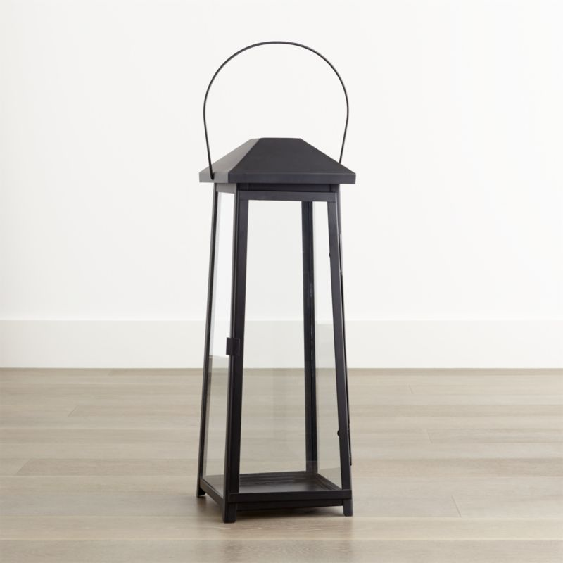 "Statuesque Petaluma takes the classic paned glass lantern to new heights. Tall, rectangular frame rises to a simple silhouette black iron to let the light shine indoors or out. Three sizes at a great price triple the impact of this modern classic.<br /><br /><NEWTAG/><ul><li>Iron</li><li>Glass</li><li>Wipe clean with damp cloth</li><li>Store inside during inclement weather</li><li>Recommended use with 6""dia.x12"" outdoor flameless pillar candle, sold separately</li><li>Made in India</li></ul>"