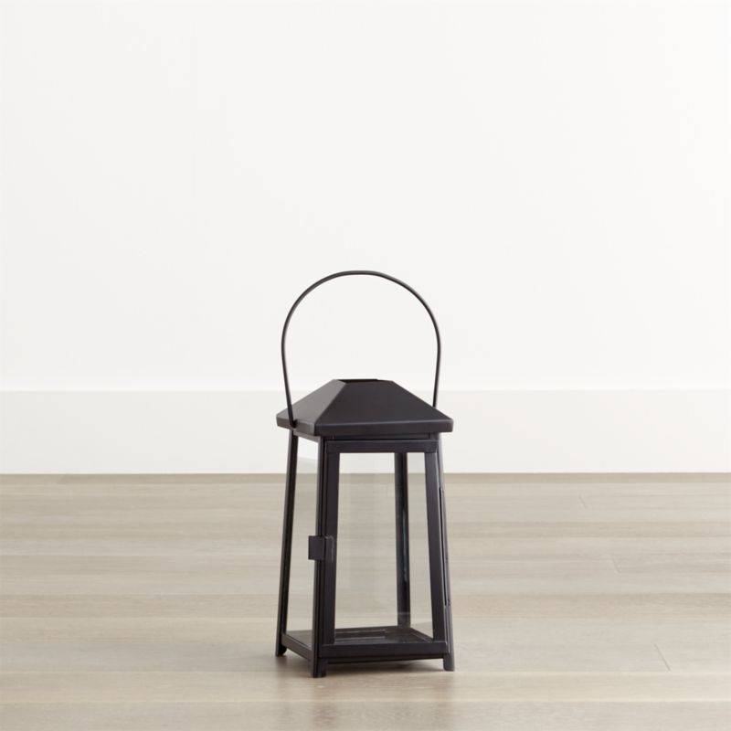 """Statuesque Petaluma takes the classic paned glass lantern to new heights. Tall, rectangular frame rises to a simple silhouette black iron to let the light shine indoors or out. Three sizes at a great price triple the impact of this modern classic.<br /><ul><li>Iron</li><li>Glass</li><li>Wipe clean with damp cloth</li><li>Store inside during inclement weather</li><li>Accommodates up to 3""""-diameter pillar candle, sold separately</li><li>Made in India</li></ul><br /><NEWTAG/>"""