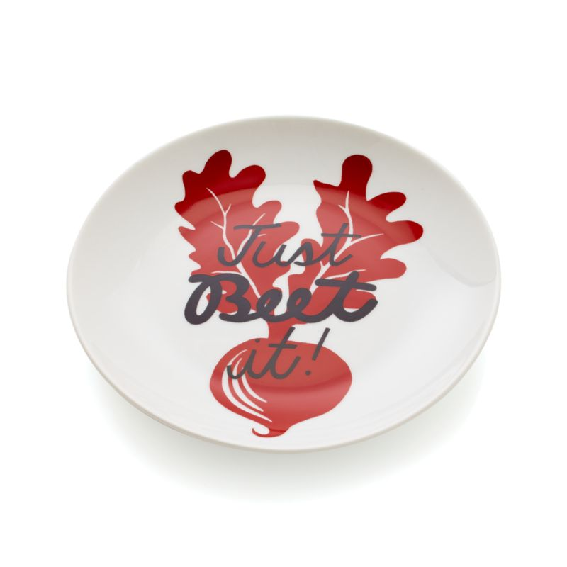 "Conversation-starting white porcelain plates showcase whimsical wordplay inscribed across fresh produce silhouettes in a range of tasty hues. Beet plate suggests ""just beet it.""<br /><br /><NEWTAG/><ul><li>Porcelain</li><li>Dishwasher-, microwave- and oven-safe to 350 degrees</li><li>Made in China</li></ul>"