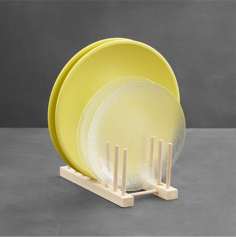 The same natural wood plate racks displayed in our stores are now available to use at home. Display a collection of favorite plates, or simply get your china cupboard organized. Two sizes available (see Large below).<br /><br /><NEWTAG/><ul><li>Natural wood with seven slots</li><li>Easy peg assembly</li><li>Made in Taiwan</li></ul>