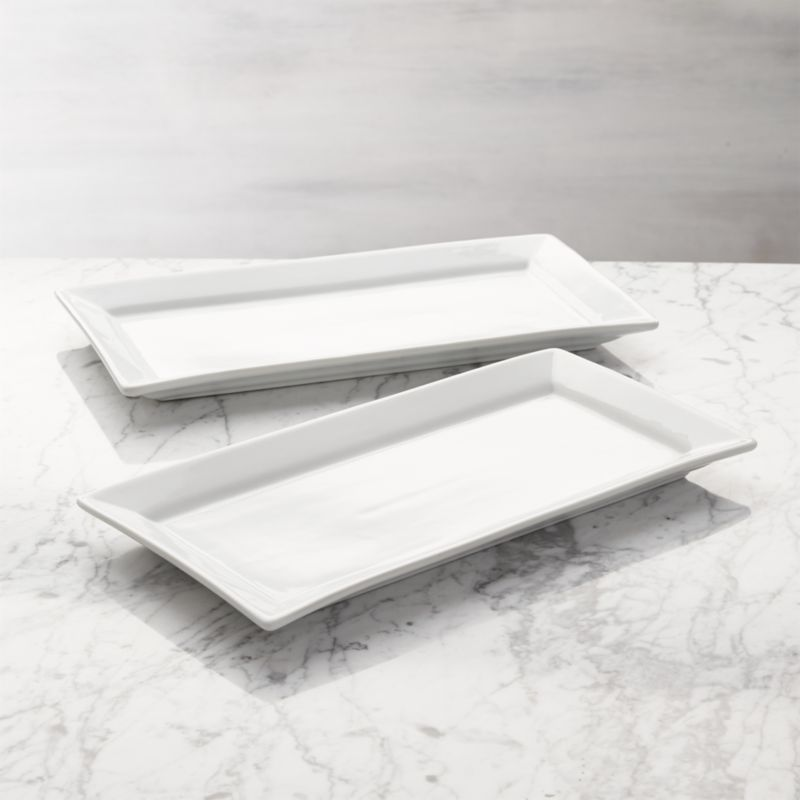 Flared porcelain rectangles to serve and display at the table or buffet. Designed to nestle in the Cambridge Two-Tier Server.<br /><br /><NEWTAG/><ul><li>White porcelain</li><li>Dishwasher- and microwave-safe</li><li>Made in China</li></ul>