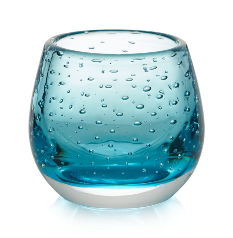 Great little globe of glass bubbles with mood-setting color, adding sparkle to a flickering tealight candle. Pure, translucent color floats on the curve of a thick, clear sham base.<br /><br /><NEWTAG/><ul><li>Glass</li><li>Accommodates a tea light candle, sold separately</li><li>Wipe with soft, dry cloth - the use of water or other liquids for cleaning may result in a loss of color</li><li>Made in China</li></ul>