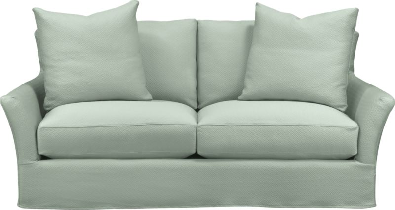 "Modern meets grace in this versatile new classic for living or family room. Unexpected clean, slim arms outwardly gesture, curve and wrap back to create a soft, relaxed silhouette from all angles. Luxe cushions relax deep. Slipcover is prewashed for a soft lived-in touch.<br /><br />Additional <a href=""http://crateandbarrel.custhelp.com/cgi-bin/crateandbarrel.cfg/php/enduser/crate_answer.php?popup=-1&p_faqid=125&p_sid=DMUxFvPi"">slipcovers</a> available below and through stores featuring our Furniture Collection.<br /><br />After you place your order, we will send a fabric swatch via next day air for your final approval. We will contact you to verify both your receipt and approval of the fabric swatch before finalizing your order.<br /><br /><NEWTAG/><ul><li>Eco-friendly construction</li><li>Certified sustainable, kiln-dried hardwood frame</li><li>Seat cushions with inner spring coil system surrounded by polyfoam with feather-down blend encased in downproof ticking</li><li>Flexolator spring suspension</li><li>Back cushions are 100% down mix wrapped in downproof ticking</li><li>Polyester-cotton blend slipcover with topstitching</li><li>Includes two 23""sq. knife-edge throw pillows</li><li>Benchmade</li><li>See additional frame options below</li></ul>"