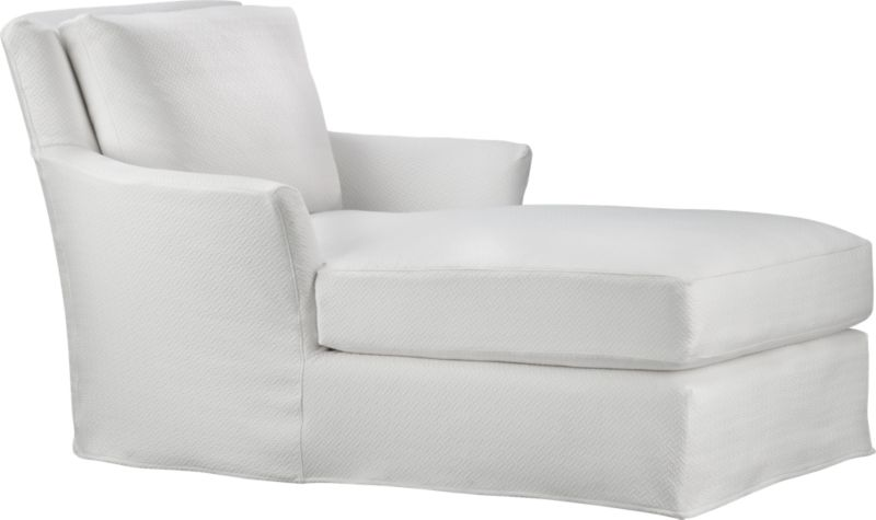 """Modern meets grace in this versatile new classic for living or family room. Slipcover fabric for Portico Chaise is tumble-washed repeatedly to achieve the soft, lived-in feel of a favorite weekend shirt.<br /><br />Additional <a href=""""http://crateandbarrel.custhelp.com/cgi-bin/crateandbarrel.cfg/php/enduser/crate_answer.php?popup=-1&p_faqid=125&p_sid=DMUxFvPi"""">slipcovers</a> available below and through stores featuring our Furniture Collection.<br /><br />After you place your order, we will send a fabric swatch via next day air for your final approval. We will contact you to verify both your receipt and approval of the fabric swatch before finalizing your order.<br /><br /><NEWTAG/><ul><li>Prewashed cotton-polyester blend slipcover with topstitch detail</li></ul><br />"""