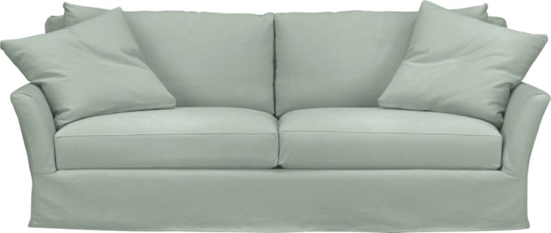 """Modern meets grace in this versatile new classic for living or family room. Slipcover for Portico Sofa is prewashed poly-cotton blend for a soft lived-in touch.<br /><br />Additional <a href=""""http://crateandbarrel.custhelp.com/cgi-bin/crateandbarrel.cfg/php/enduser/crate_answer.php?popup=-1&p_faqid=125&p_sid=DMUxFvPi"""">slipcovers</a> available below and through stores featuring our Furniture Collection.<br /><br />After you place your order, we will send a fabric swatch via next day air for your final approval. We will contact you to verify both your receipt and approval of the fabric swatch before finalizing your order.<br /><br /><NEWTAG/><ul><li>Polyester-cotton blend with topstitching</li><li>Machine wash</li></ul>"""