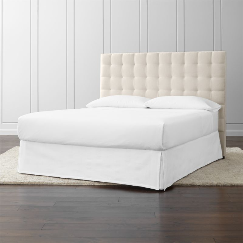 Lining up on the grid as a tall presence for the contemporary bedroom, our Quadrant California king headboard is wrapped in a soft, cotton-poly blend fabric. Buttonless tufting detail adds casual definition and visual interest. The Quadrant California King Headboard is a Crate and Barrel exclusive.<br /><br /><NEWTAG/><ul><li>Frame is benchmade with certified sustainable hardwood that's kiln-dried to prevent warping</li><li>Soy-based polyfoam cushioning</li><li>Solid maple legs with brown finish</li><li>Headboard requires a bed frame (sold separately)</li><li>When attached to Crate and Barrel bed frame no additional hardware required; accommodates mattress and box spring (sold separately)</li><li>Non-Crate and Barrel bed frame may require a Modi-Plate Kit (sold separately)</li><li>Made in North Carolina, USA</li></ul>