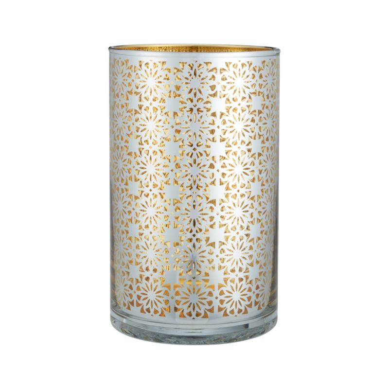 "Eastern-inspired filigree casts an exotic glow in luxe metallics. Rich gold interior flickers warm candlelight through lacy laser-cut pattern electroplated in silver.<br /><br /><NEWTAG/><ul><li>Clear glass</li><li>Electro-plated laser-cut pattern</li><li>Accommodates up to a 3""pillar candle, sold separately</li><li>Clean with a damp cloth</li><li>Made in China</li></ul>"