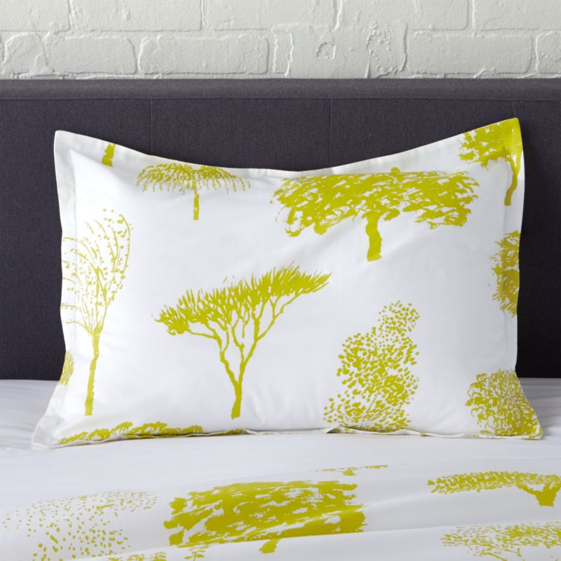 """Global forest plants citron silhouettes of the world's trees on crisp white cotton percale bedding, artfully rendered in designer Fujiwo Ishimoto's painted design. Inspired by his observations of nature in many settings, the pattern is named Rantapuisto, a Finnish word meaning """"beach park."""" Sham has a 1"""" flange and generous overlapping back closure. Bed pillows available.<br /><br /><NEWTAG/><ul><li>Designed by Fujiwo Ishimoto</li><li>100% cotton percale</li><li>300-thread-count</li><li>1"""" flange and overlapping back closure</li><li>Machine wash cold, tumble dry low; warm iron as needed</li><li>Made in Pakistan</li></ul>"""