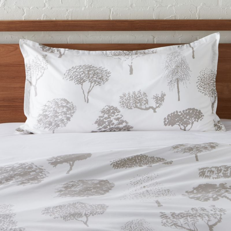 """Global forest plants grey silhouettes of the world's trees on crisp white cotton percale bedding, artfully rendered in designer Fujiwo Ishimoto's painted design. Inspired by his observations of nature in many settings, the pattern is named Rantapuisto, a Finnish word meaning """"beach park."""" Sham has a 1"""" flange and generous overlapping back closure. Bed pillows available.<br /><br /><NEWTAG/><ul><li>Designed by Fujiwo Ishimoto</li><li>100% cotton percale</li><li>300-thread-count</li><li>1"""" flange and overlapping back closure</li><li>Machine wash cold, tumble dry low; warm iron as needed</li><li>Made in Pakistan</li></ul>"""