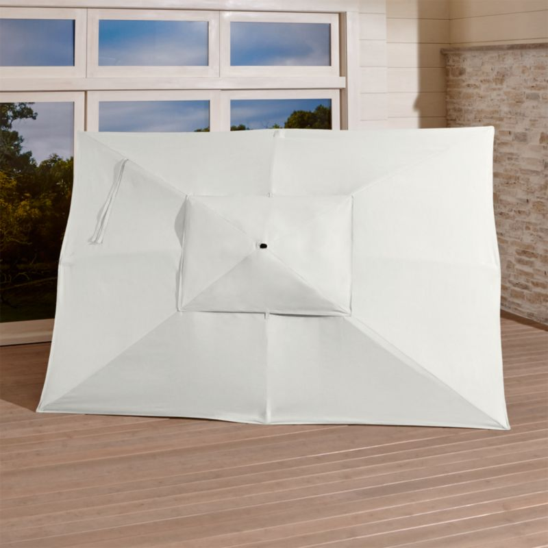 """An oversized canopy of fade- and mildew-resistant Sunbrella® acrylic in warm white sand blocks up to 98% of the sun's UV rays. Fits all of our rectangular frames. For frame and stand options with this cover, see below (frames and stands sold separately).<br /><br /><NEWTAG/><ul><li>Cover: fade- and mildew-resistant Sunbrella acrylic umbrella (fits all our rectangular frames; spot clean)</li><li>Frames (sold separately): adjustable FSC-certified eucalyptus with solid brass pulley; or aluminum with black finish</li><li>Stands (sold separately): rustproof poly resin and stone-polyester mixture, in charcoal finish</li><li>Small stand accommodates our rectangular umbrellas with metal frames</li><li>Large stand works with any of our umbrella frames: accommodates 1.5""""dia. frame with adapter, or 1.875""""dia. frame without adapter</li><li>Large stand works with a table or on its own</li><li>Made in USA</li></ul>"""