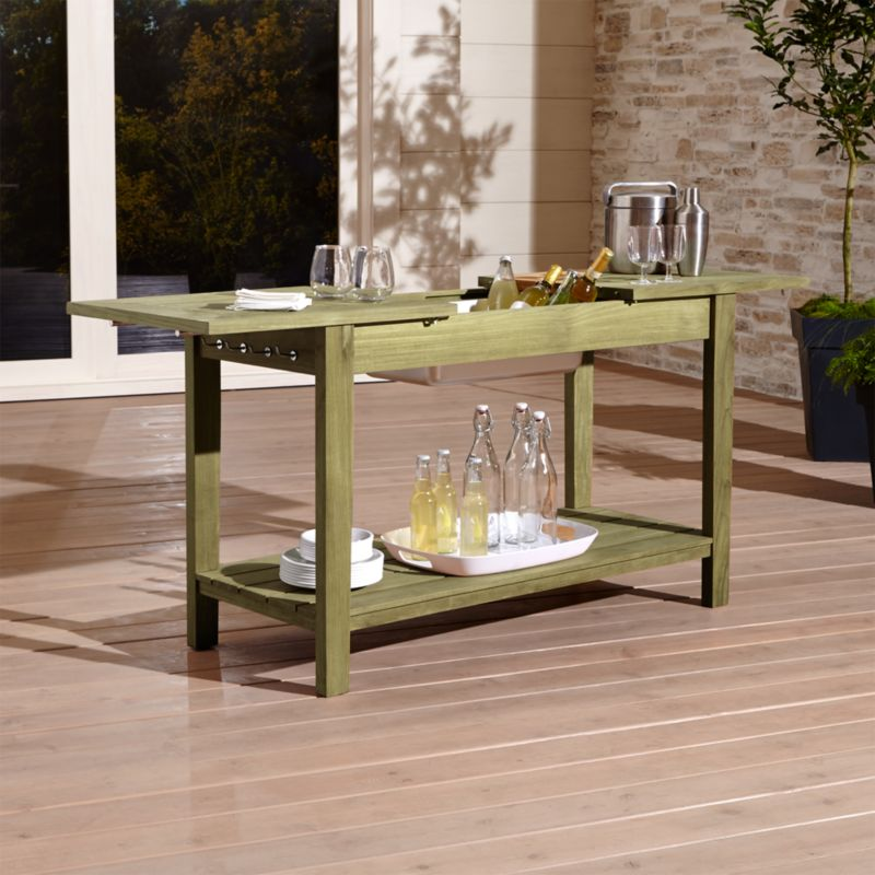 This mulitipurpose outdoor bar-table-work station sets the gold standard for sustainably sourced teak, meeting every requirement of the Forest Stewardship Council (FSC), a nonprofit organization that encourages responsible management of the world's forests. Each piece cuts a clean, classic profile with a bold wide-slat design. <NEWTAG/><ul><li>Handcrafted</li><li>Solid FSC-certified teak</li><li>Unfinished</li><li>Stainless steel tub insert</li><li>Mortise-and-tenon joinery</li><li>Stainless steel hardware</li><li>4 side storage hooks</li><li>Made in Indonesia</li></ul><br />