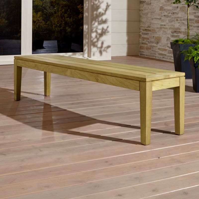 Our exclusive Regatta outdoor dining bench pulls up to the table with a clean, classic profile in a bold wide-slat design. Bench is handcrafted of Grade A plantation-grown teak, the highest quality teak in the world, that's certified by the Forest Stewardship Council (FSC). <NEWTAG/><ul><li>Handcrafted</li><li>Solid FSC-certified teak</li><li>Unfinished</li><li>Mortise-and-tenon joinery</li><li>Stainless steel hardware</li><li>Seats up to 3</li><li>Made in Indonesia</li></ul><br />