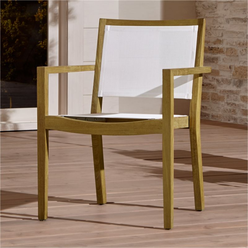 Our exclusive Regatta outdoor mesh dining chair cuts a clean, classic profile in a bold wide-slat design handcrafted of Grade A plantation-grown teak, the highest quality teak in the world. Mesh dining chair features UV- and fade-resistant white Batyline ® inserts. <NEWTAG/><ul><li>Handcrafted</li><li>Solid FSC-certified teak</li><li>Unfinished</li><li>White Batyline synthetic mesh inserts</li><li>Mortise-and-tenon joinery</li><li>Stainless steel hardware</li><li>Stackable</li><li>Made in Indonesia</li></ul><br />