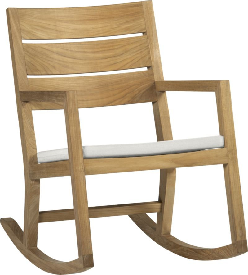 Our eco-friendly Regatta teak dining collection cuts a clean, classic profile in a bold wide-slat design. Mid-size rocking chair is handcrafted of quality plantation-grown teak supported by the TFT, a nonprofit organization that promotes responsible forest conservation. We recommend allowing the teak to weather to a silvery grey. To maintain the natural color, use our Golden Care® Teak Protector. Optional cushion is fade- and mildew-resistant Sunbrella® acrylic in warm white sand.<br /><br /><NEWTAG/><ul><li>Solid teak harvested from plantations working with TFT</li><li>Mortise-and-tenon joinery</li><li>Stainless steel hardware</li><li>Cushion is fade- and mildew-resistant Sunbrella acrylic</li><li>Polyester batting and foam cushion fill</li><li>Cushion is secured with fabric tab fasteners</li><li>Spot clean the cushion cover</li></ul>