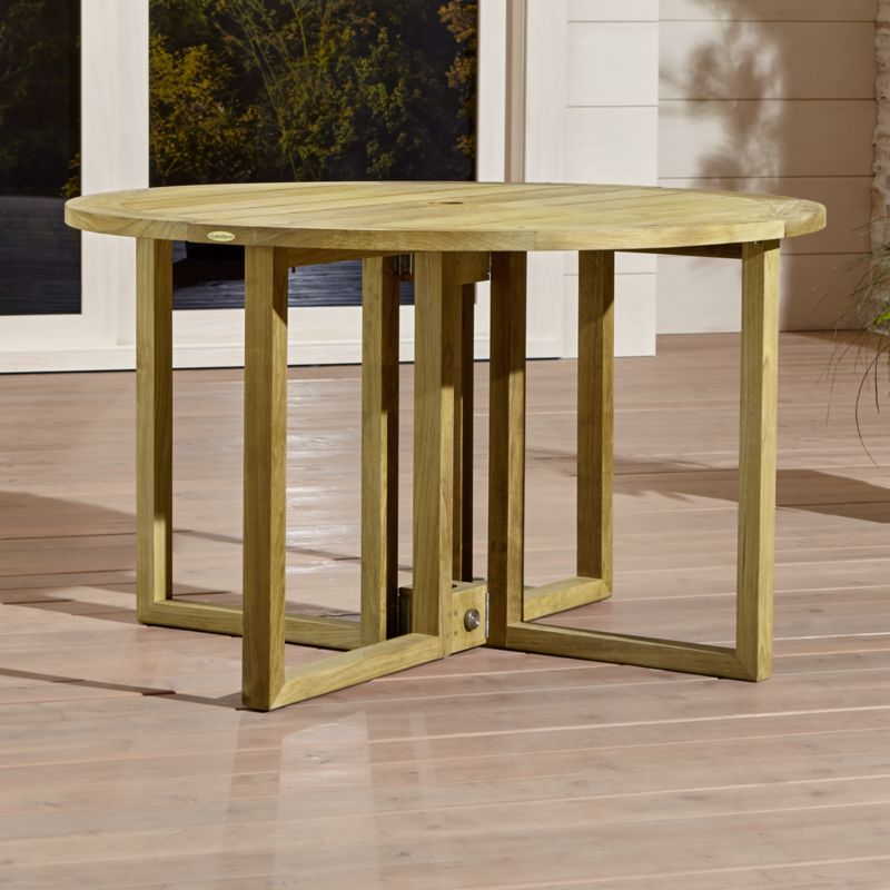 Handcrafted of the world's highest quality teak, our exclusive Regatta round drop-leaf table cuts a clean, classic profile in a bold wide-slat design.  Grade A plantation-grown teak, certified by the Forest Stewardship Council (FSC), is an investment that can weather the elements year after year. <NEWTAG/><ul><li>Handcrafted</li><li>Solid FSC-certified teak</li><li>Unfinished</li><li>Mortise-and-tenon joinery</li><li>Stainless steel hardware</li><li>Seats up to 4</li><li>Umbrella opening with self-storing plug provided</li><li>Made in Indonesia</li></ul><br />