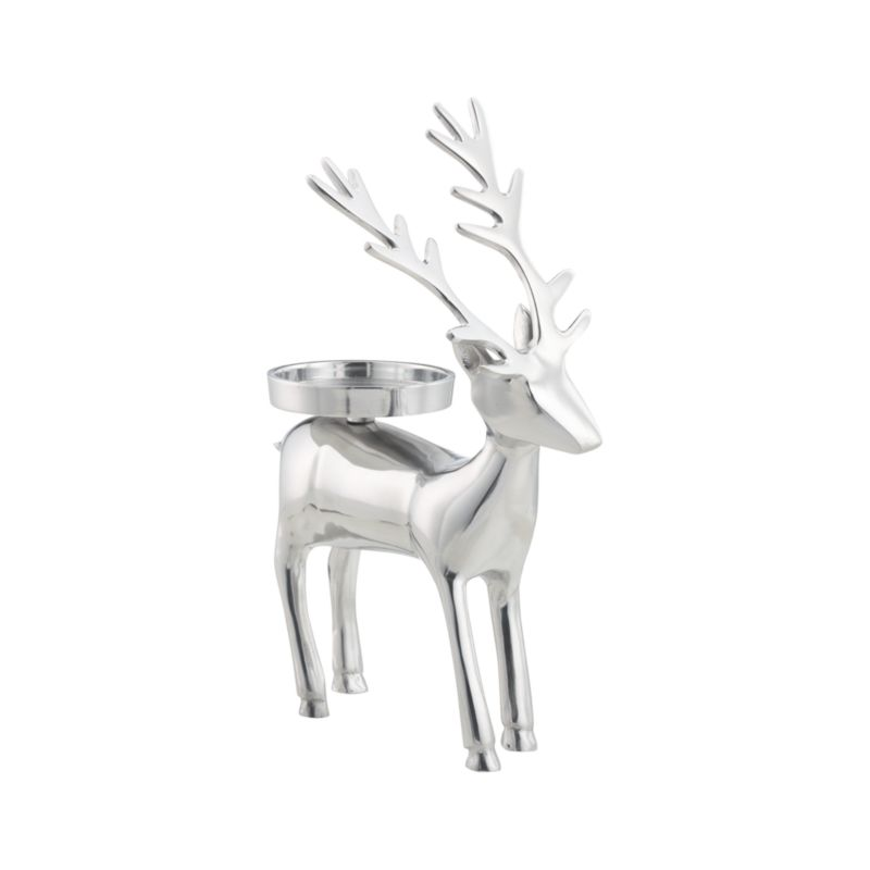 """Shiny reindeer balances a single pillar on its back to brighten faces as well as tables, mantels and holiday displays. Handmade of aluminum.<br /><br /><NEWTAG/><ul><li>Handmade</li><li>Aluminum</li><li>Pillar Candleholder accommodates a 3""""-dia. pillar candle, sold separately</li><li>Wipe with damp soft cloth</li></ul>"""
