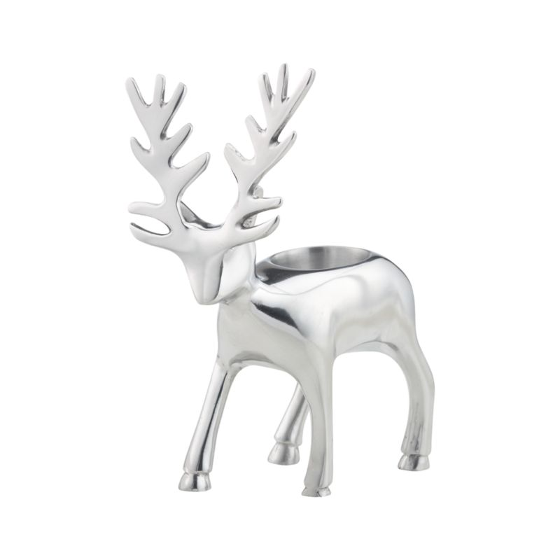 Shiny reindeer balances a single tealight on its back to brighten faces as well as tables, mantels and holiday displays. Handmade of aluminum.<br /><br /><NEWTAG/><ul><li>Handmade</li><li>Aluminum</li><li>Reindeer Tealight Candleholder accommodates one tealight candle, sold separately</li><li>Wipe with damp soft cloth</li></ul>