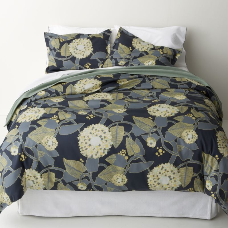 """Winding vines and bounteous blossom heads bloom soft neutrals on charcoal in this 2008 botanical pattern by Anu Luhtanan. This nature-inspired design is named after the springtime bloom of birch branches (""""Ritva""""). Reversible duvet cover has hidden button closure at bottom and interior fabric ties to hold the insert in place. Duvet inserts also available.<br /><br /><NEWTAG/><ul><li>Pattern designed by Anu Luhtanan; 2008</li><li>100% cotton sateen</li><li>300-thread-count</li><li>Machine wash cold, tumble dry low; warm iron as needed</li><li>Made in Pakistan</li></ul>"""