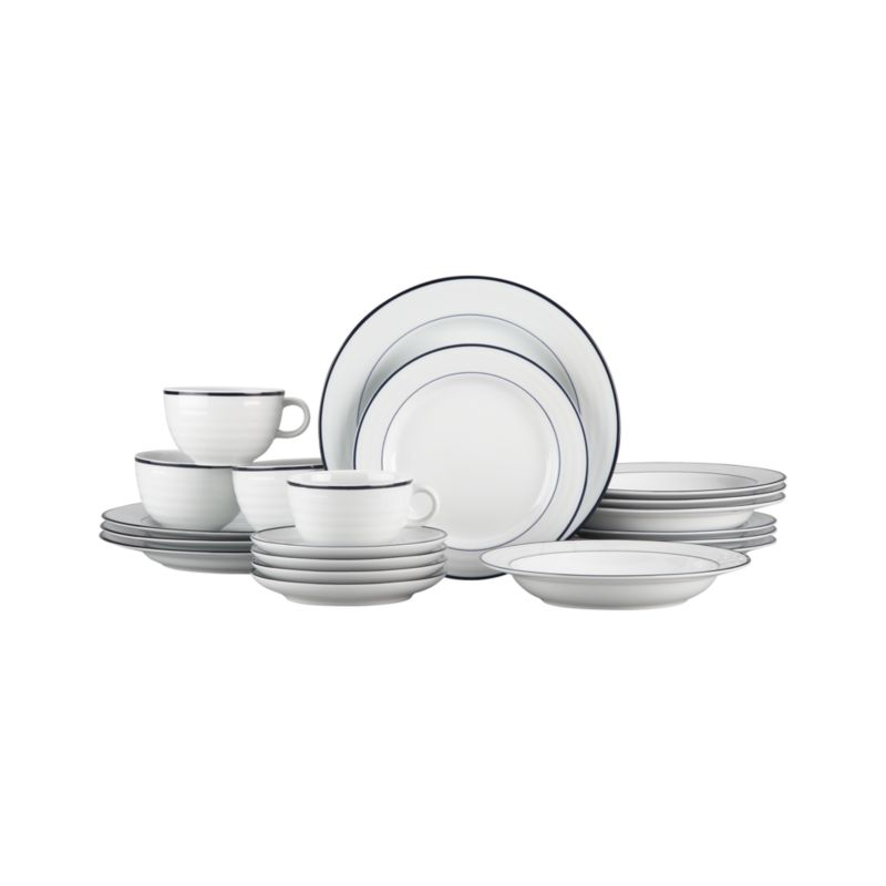 "Your table will be dressed for success in this tailored cousin to our all-white Roulette dinnerware, a top-selling, customer-favorite for 23 years. Designed by Martin Hunt of Queensberry Hunt, this porcelain 20-piece set of four 5-piece place settings features contemporary shapes accented with crisp navy bands and rims. Mix and match with our original white Roulette dinnerware.<br /><br />We've got <a href=""/ideas-and-advice/table-decorating-ideas"">six great table decorating ideas</a>.<br /><br /><NEWTAG/><ul><li>Designed by Martin Hunt of Queensberry Hunt</li><li>Porcelain</li><li>Dishwasher-, microwave- and warm oven-safe</li><li>Made in Portugal</li></ul>"