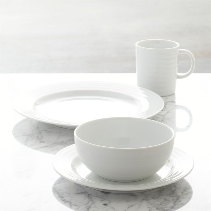 Designed by Martin Hunt of Queensberry Hunt, Roulette dinnerware has been a top-selling Crate and Barrel favorite since the pattern was introduced in 1992. Crafted of durable, pure white porcelain, Roulette features subtle concentric circles that create an eye-catching rippled effect.  Mix and match with our Roulette Blue Band dinnerware.<br /><br /><NEWTAG/><ul><li>Designed by Martin Hunt of Queensberry Hunt</li><li>Porcelain</li><li>Dishwasher-, microwave- and warm oven-safe</li><li>Made in Portugal</li></ul>