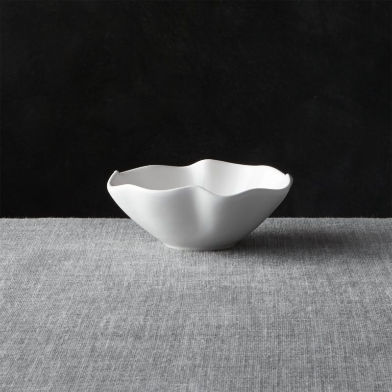 Freeform waves of ruffles and folds in high-gloss white earthenware make a big impression at the table or buffet. Platter and dip/condiment bowl work separately or as a team (see additional photos).<br /><br /><NEWTAG/><ul><li>Earthenware</li><li>14 oz.</li><li>Dishwasher safe on low heat setting</li><li>Made in Portugal</li></ul><br />