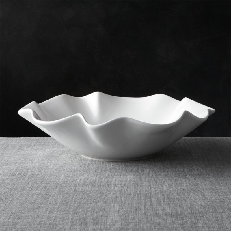 Freeform waves of ruffles and folds in high-gloss white earthenware make a big impression at the table or buffet.<br /><br /><NEWTAG/><ul><li>Earthenware</li><li>Dishwasher safe on low heat setting</li><li>Made in Portugal</li></ul>