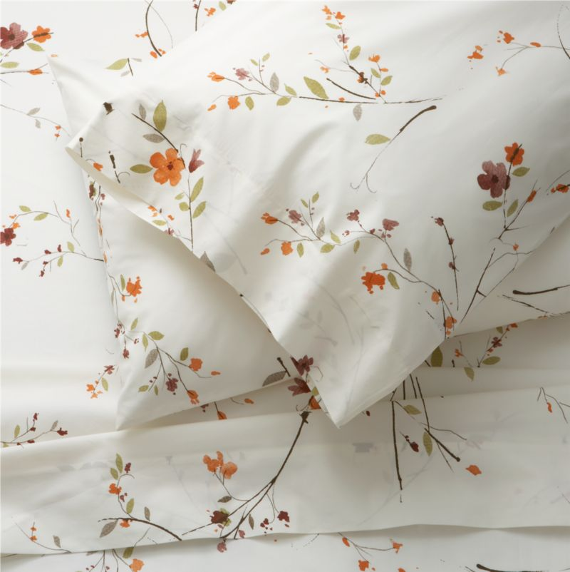 Ikebana inspiration for your personal space. A botanical pigment print with a washed look in burnt oranges, greens and rust with brown branches is scattered across a soft white background. Sheet set includes one flat sheet, one fitted sheet and two standard pillowcases. Bed pillows also available.<br /><br /><NEWTAG/><ul><li>100% cotton</li><li>Super-soft 310-thread-count</li><li>Machine wash</li><li>Made in Portugal</li></ul>