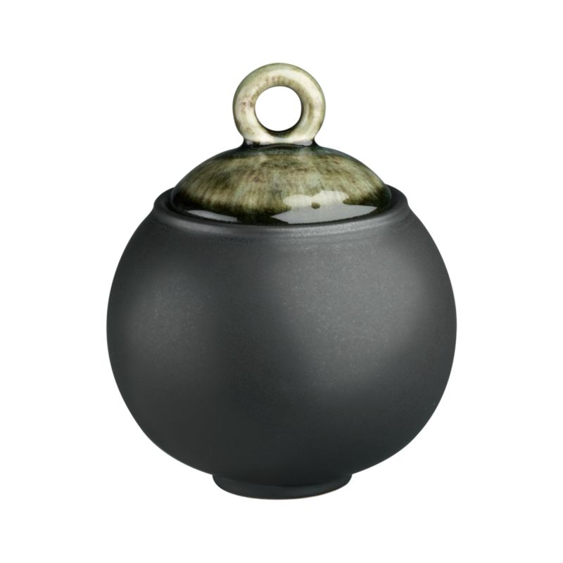 "Earthy, Asian-inspired sugar bowl is both chic and soothing in hues of black and moss green. Minimal modern styling allows the color drama to take center stage. Unique shape is both casual and elegant; the inviting reactive glaze on the lid ensures that no two pieces are exactly alike. Satin exterior finish has a ""cast iron"" appeal. Quality and integrity of design, only from one of France's original ceramic factories. Samoa dinnerware also available.<br /><br /><strong>Please note:</strong> This pattern will be discontinued in January 2013. When our current inventory is sold out, it is unlikely we will be able to obtain more.<br /><br /><NEWTAG/><ul><li>Unique shape</li><li>Dishwasher- and microwave-safe</li></ul><br />"