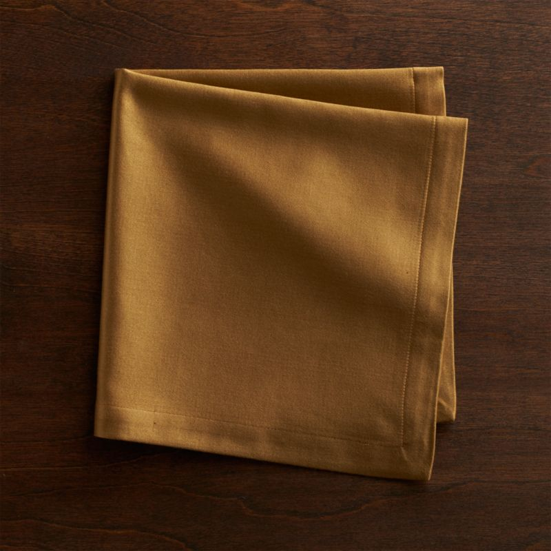 """Rayon/cotton blend sateen napkin complements casual and formal dining with elegant sheen and versatile solids. Napkin is tailor finished with 1"""" hem and mitered corners.<br /><br /><NEWTAG/><ul><li>55% rayon and 45% cotton</li><li>Machine wash cold, dry flat; warm iron as needed</li><li>Do not dry clean, tumble dry or bleach</li><li>Made in India</li></ul>"""