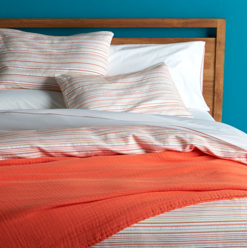 Sun-kissed stripes of coral and yellow freshen our Seaside cotton bedding with the summery crispness of seersucker.  Duvet cover reverses to solid white and features a hidden button closure and interior fabric ties to hold the insert in place. Duvet inserts also available.<br /><br /><NEWTAG/><ul><li>100% cotton</li><li>Machine wash cold, tumble dry low</li><li>Hidden button closure and interior fabric ties</li><li>Machine wash cold, tumble dry low</li><li>Made in Portugal</li></ul><br />