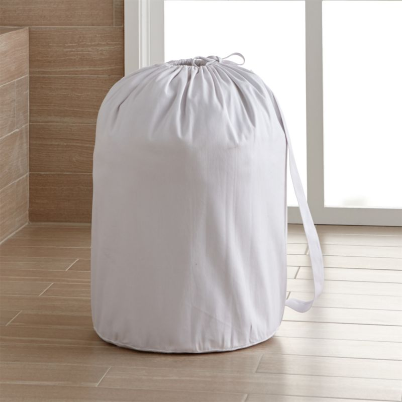 Washable cotton canvas liner has a drawstring closure and carrying strap. Each handmade piece will vary slightly in size.<br /><br />Machine wash 100% cotton canvas liner<br />Made in China