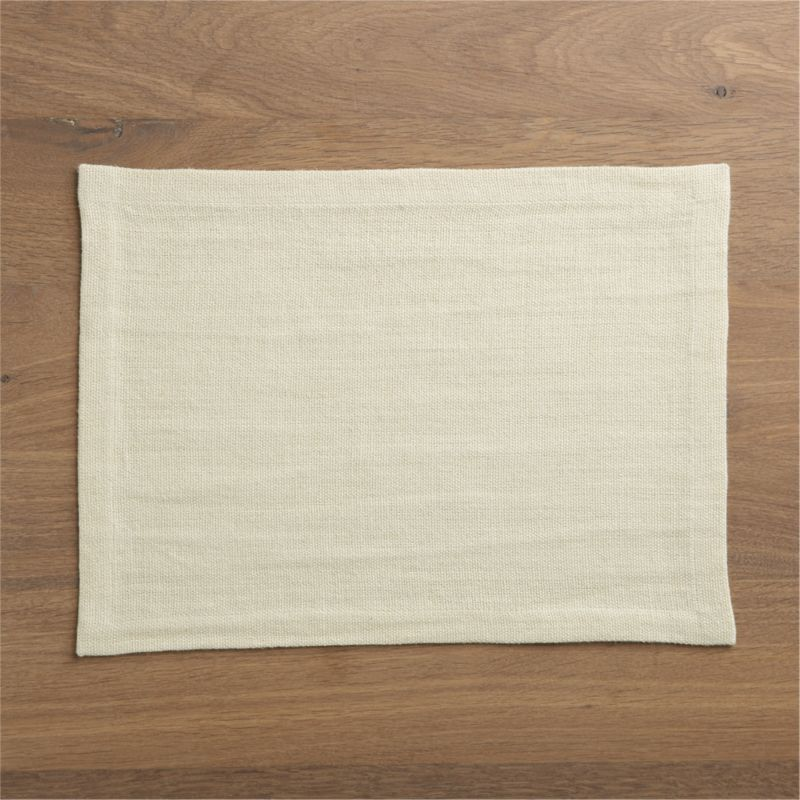 Beautiful ivory linen placemat sets a neutral, subtly textured stage, putting all kinds of dinnerware in a starring role.<br /><br /><NEWTAG/><ul><li>100% linen</li><li>Machine wash, dry flat; warm iron as needed</li></ul>