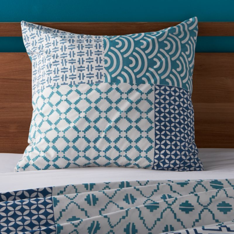 """An exquisite balance of graphic motifs is hand block-printed in a rich geometric """"patchwork"""" of soft, sophisticated blues. This early form of textile printing is considered one of the most artistic and time-consuming methods.  Shams have an all-over print and overlapping back closure. Bed pillows also available.<br /><br /><NEWTAG/><ul><li>100% cotton</li><li>Hand block-printed</li><li>Overlapping back closure</li><li>Machine wash, tumble dry low</li><li>Made in India</li></ul><br />"""