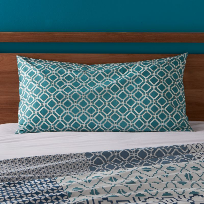 "An exquisite balance of graphic motifs is hand block-printed in a rich geometric ""patchwork"" of soft, sophisticated blues. This early form of textile printing is considered one of the most artistic and time-consuming methods.  Shams have an all-over print and overlapping back closure. Bed pillows also available.<br /><br /><NEWTAG/><ul><li>100% cotton</li><li>Hand block-printed</li><li>Overlapping back closure</li><li>Machine wash, tumble dry low</li><li>Made in India</li></ul><br />"