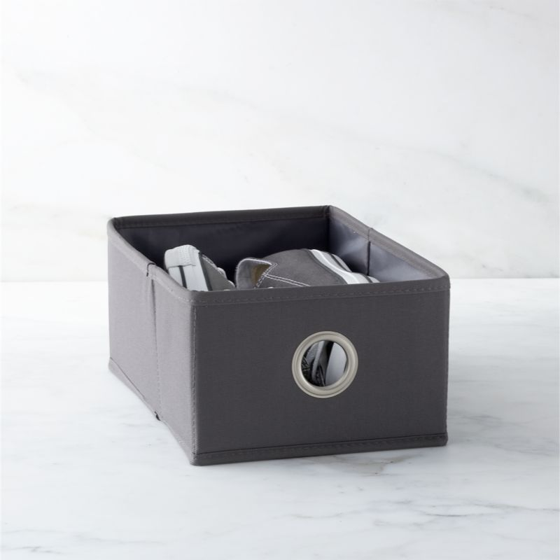 Shoe drawer in grey with a nickel-plated grommet neatly stows footwear, small garments and accessories in our coordinating hanging shoe bag or 20-section hanging bag. Drawer folds flat for storage when not in use.<br /><br /><NEWTAG/><ul><li>Heavy-duty polyester and cardboard</li><li>Satin nickel-plated grommet</li><li>Clean with a damp cloth</li><li>Made in China</li></ul><br />