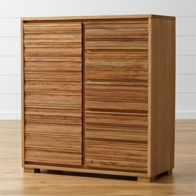 A distinctive storage piece equally suited to the bedroom or living room, our Sierra wardrobe is crafted in a naturally beautiful union of reclaimed teak and solid European white oak. Richly textured horizontal detailing lines up in strips of repurposed teak, salvaged from spare production materials and steel-brushed to highlight the grain's tone and texture. <NEWTAG/><ul><li>Solid European white oak frame finished with oil and wax</li><li>Solid, steel-brushed repurposed teak finished with clear topcoat</li><li>As with all solid woods, expansion and contraction may occur with seasonal changes in humidity</li><li>Tongue-and-groove joinery</li><li>5 drawers with integrated pulls</li><li>Undermount metal drawer glides</li><li>2 adjustable/removable shelves</li><li>Removable metal hanging bar</li><li>Made in Vietnam</li></ul>