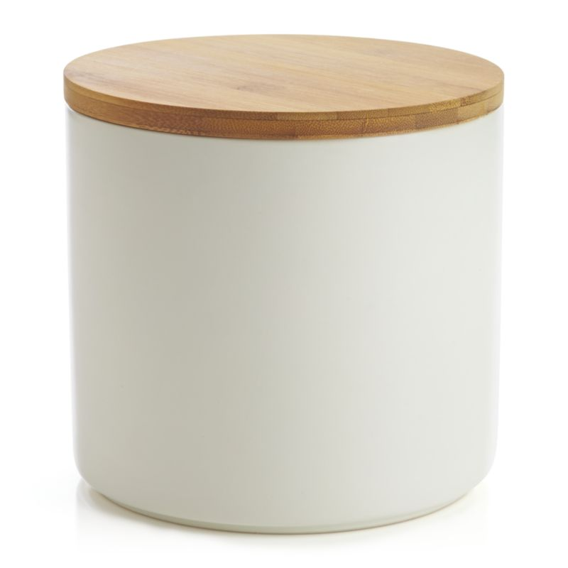 Clean, contemporary styling in durable stoneware, warmed by a winter-white glaze and natural bamboo lid. Silicone lid gasket forms a tight seal, locking in freshness and locking out moisture. Stackable canisters store staples in style on the countertop or pantry.<br /><br /><NEWTAG/><ul><li>Stoneware</li><li>Matte glaze finish</li><li>Bamboo lid with silicone gasket</li><li>BPA-free</li><li>Canister is dishwasher-safe</li><li>Hand wash the bamboo lid</li><li>Bamboo lid will darken over time</li><li>Made in China</li></ul>