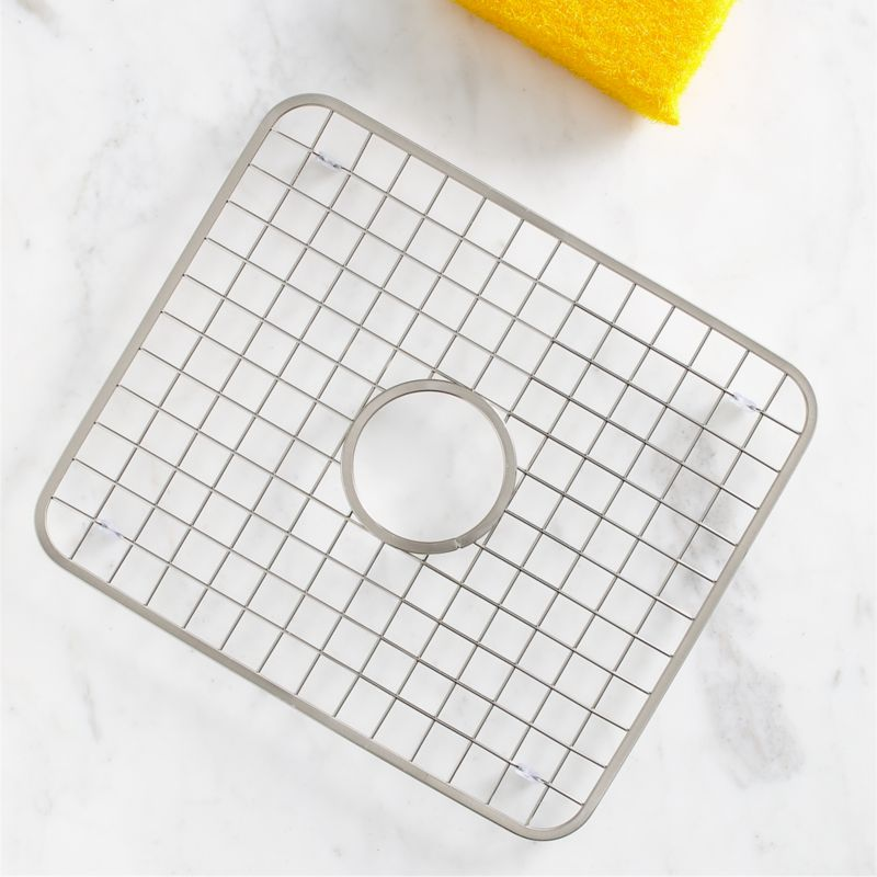 Nonslip and rustproof, this footed stainless grid with satin finish gets between the sink and the contents to limit dishwashing damage to your dinnerware, stemware, pots and sink surface. Outfitted with a central drainage hole.<br /><br /><NEWTAG/><ul><li>18/8 stainless steel</li><li>Satin finish</li><li>Nonslip rubber feet</li><li>Hand wash</li><li>Made in China</li></ul>