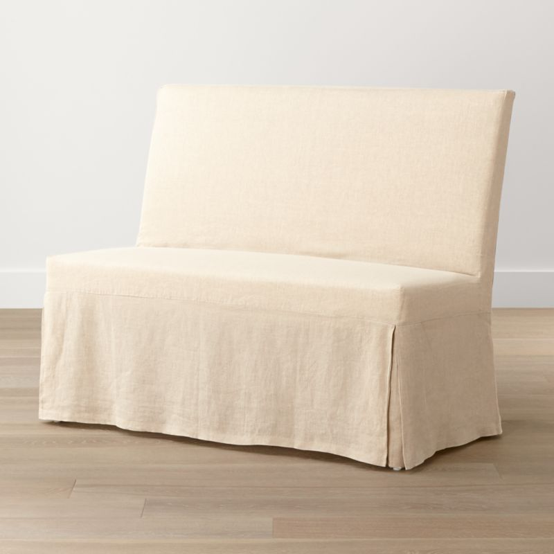 Our streamlined Slip Bench offers casual, open seating with a comfortably angled back and natural-linen slipcover. <NEWTAG/><ul><li>Solid beechwood frame</li><li>Webbing suspension system</li><li>Polyfoam cushion seat and back</li><li>Base is covered in 100 percent cotton muslin</li><li>Removable 100 percent linen slipcover</li><li>Seats 2</li><li>Made in China and India</li></ul><br />