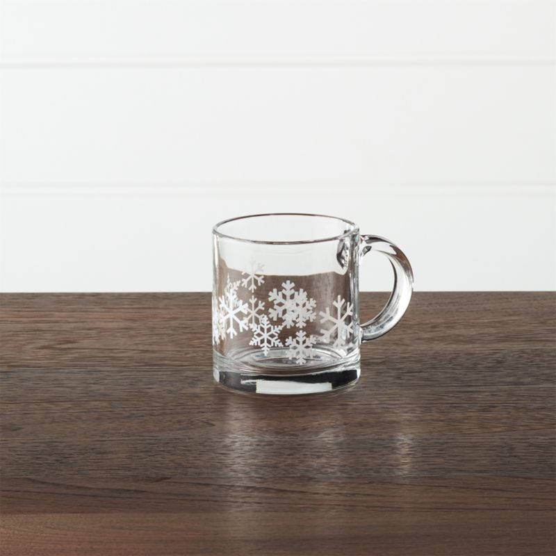 Pure white snowflakes come into focus when you pour your favorite beverage into this contemporary straight-up mug with oversized handle.<br /><br /><NEWTAG/><ul><li>Glass</li><li>Dishwasher- and microwave-safe</li><li>Made in Mexico</li></ul>