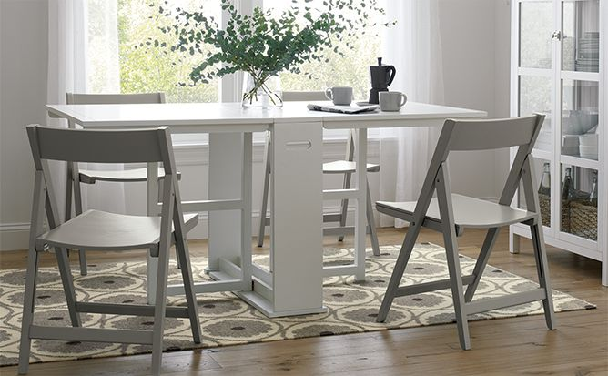 Wooden white gateleg dining table and grey folding dining chair