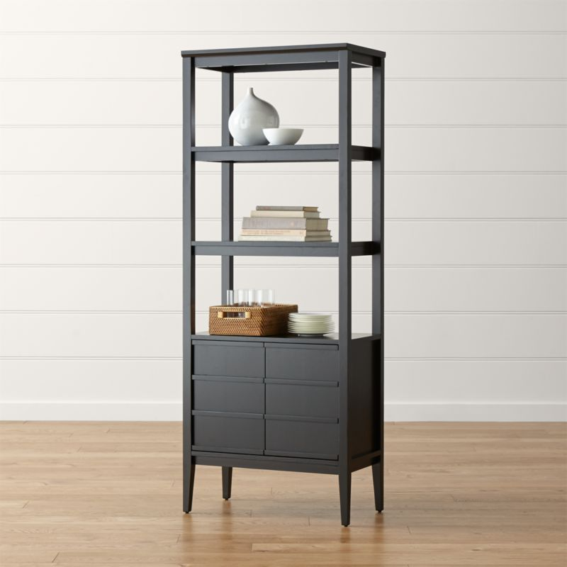 Spotlight highlights simple, smart storage using sleek, clean lines and a high-gloss white finish. The freestanding bookcase offers two upper shelves for display and a closed storage cabinet below. <NEWTAG/><ul><li>Designed by Mark Daniel of Slate</li><li>Solid and engineered wood and birch veneer frame</li><li>Ebony stain and protective topcoat</li><li>One adjustable and two fixed shelves</li><li>Made in Vietnam</li></ul><br />