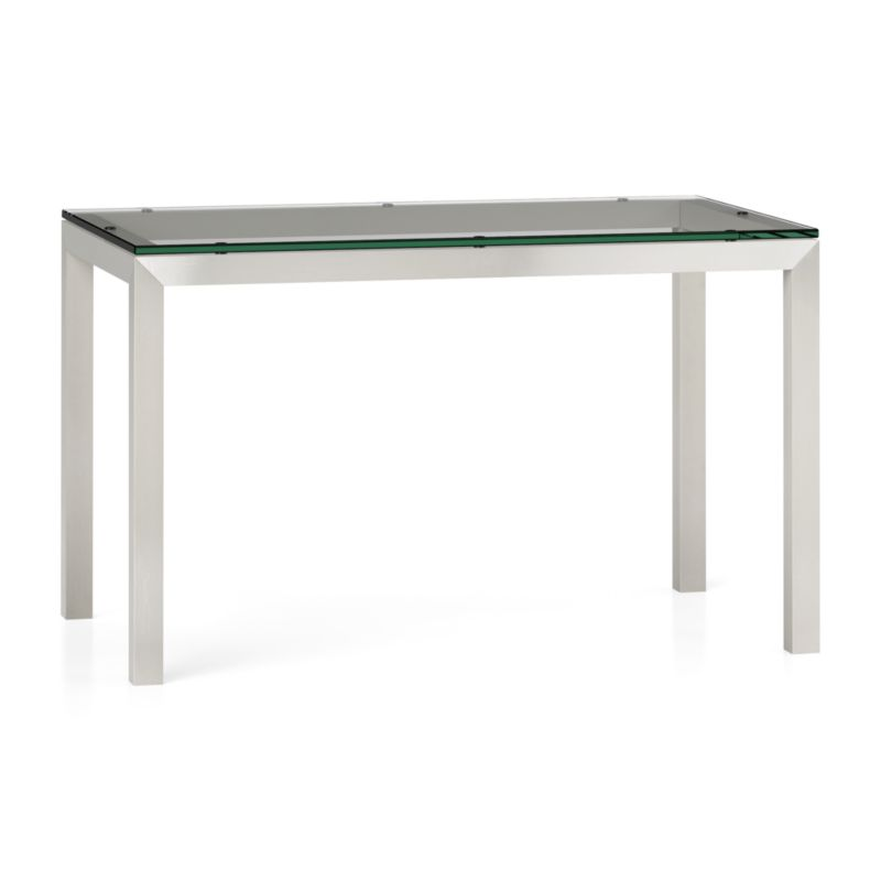 """You've designed your ideal table, from top to bottom in just the right size. Clear float glass makes a transparent top that's ⅝-inch thick with a flat, polished edge. To complement its clean, simple lines, this stainless steel Parsons-style frame gets a soft, contemporary brushed finish that mimics mitered wood corners. Perfect for kitchens and smaller spaces, this table seats up to 4. The Parsons Clear Glass Top/ Stainless Steel Base 48x28 Dining Table is a Crate and Barrel exclusive.<br /><br /><NEWTAG/><ul><li>⅝"""" glass top with flat polished edge</li><li>Non-tempered glass</li><li>Stainless steel base with brushed finish</li><li>Foot caps</li><li>Seats 4</li><li>Made in China</li></ul>"""