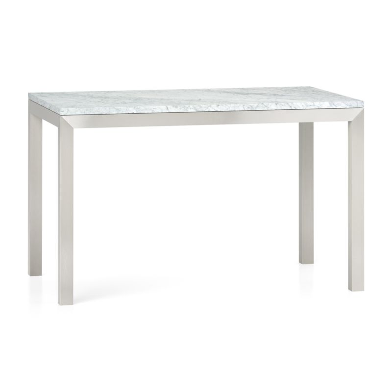 You've designed your ideal table, from top to bottom in just the right size. The polished Italian Carrara marble top displays the unique markings and color variations of pure, unfinished stone. To complement its clean, simple lines, this stainless steel Parsons-style frame gets a soft, contemporary brushed finish that mimics mitered wood corners. Perfect for kitchens and smaller spaces, this table seats up to 4. The Parsons White Marble Top/ Stainless Steel Base 48x28 Dining Table is a Crate and Barrel exclusive.<br /><br /><NEWTAG/><ul><li>Polished Italian Carrara marble top over honeycomb aluminum core to reduce weight and limit cracking</li><li>Slight tolerance for fit to base is characteristic of the marble</li><li>Stainless steel base with brushed finish</li><li>Foot caps</li><li>Seats 4</li><li>Made in China</li></ul>