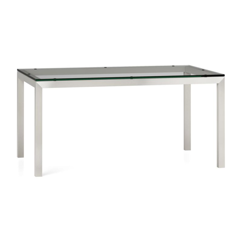 """You've designed your ideal table, from top to bottom in just the right size. Clear float glass makes a transparent top that's ⅝-inch thick with a flat, polished edge. To complement its clean, simple lines, this stainless steel Parsons-style frame gets a soft, contemporary brushed finish that mimics mitered wood corners. Sized to seat up to 6, this table is perfect for everyday dining or entertaining. The Parsons Clear Glass Top/ Stainless Steel Base 60x36 Dining Table is a Crate and Barrel exclusive.<br /><br /><NEWTAG/><ul><li>⅝"""" glass top with flat polished edge</li><li>Non-tempered glass</li><li>Stainless steel base with brushed finish</li><li>Foot caps</li><li>Seats 6</li><li>Made in China</li></ul>"""