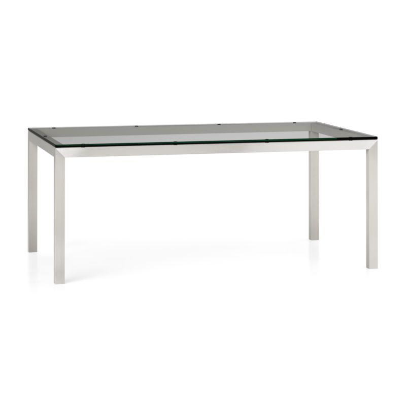"You've designed your ideal table, from top to bottom in just the right size. Clear float glass makes a transparent top that's ⅝-inch thick with a flat, polished edge. To complement its clean, simple lines, this stainless steel Parsons-style frame gets a soft, contemporary brushed finish that mimics mitered wood corners. Generously sized table is great for entertaining, seating up to 8. The Parsons Clear Glass Top/ Stainless Steel Base 72x42 Dining Table is a Crate and Barrel exclusive.<br /><br /><NEWTAG/><ul><li>⅝"" glass top with flat polished edge</li><li>Non-tempered glass</li><li>Stainless steel base with brushed finish</li><li>Foot caps</li><li>Seats 8</li><li>Made in China</li></ul>"