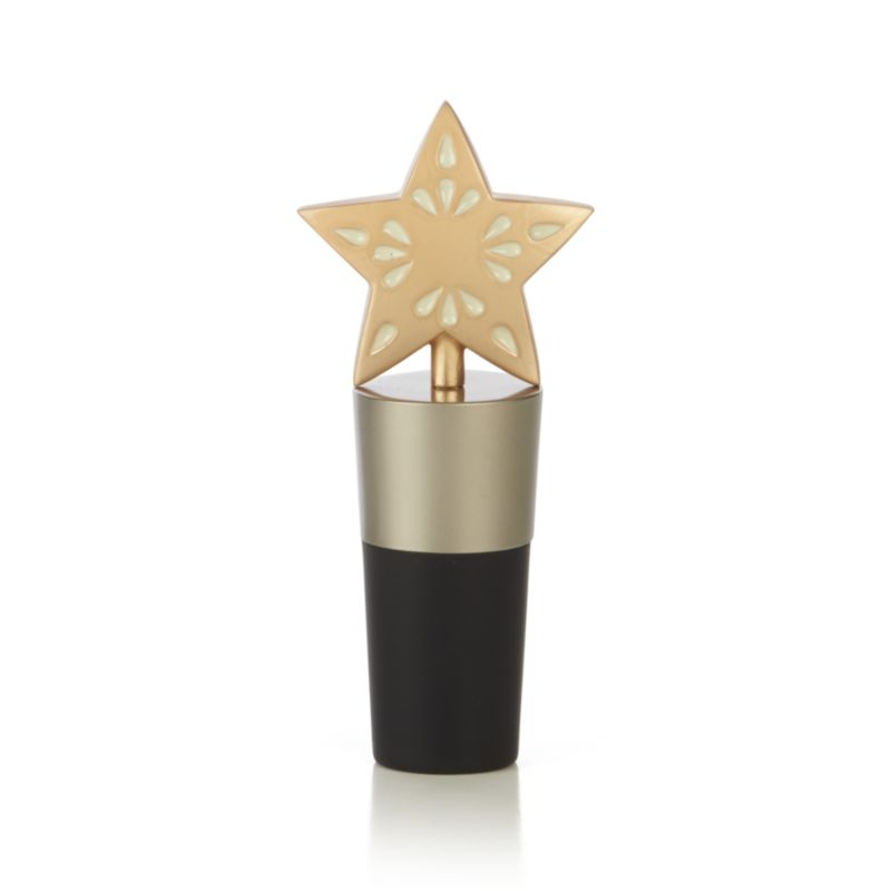 Elegant bottle stopper dresses up wine bottles with a sculptural, gold-toned star ornament topper. Rubber stopper seals and keeps out air to keep opened wine fresh.<br /><br /><NEWTAG/><ul><li>Zinc alloy topper with matte gold finish</li><li>Rubber stopper</li><li>Made in China</li></ul>