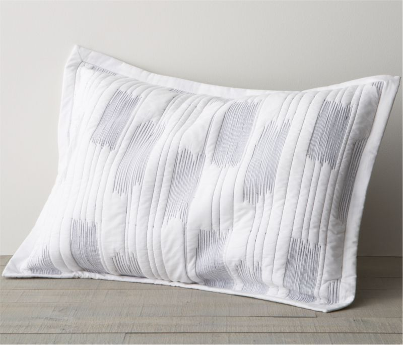 Thin blue line tracks fine lines and occasional zigzag blocks on crisp white cotton for a fresh and contemporary bed. One-inch flange and envelope enclosure. Bed pillows also available.<br /><br /><NEWTAG/><ul><li>100% cotton</li><li>100% cotton fill</li><li>Machine wash, tumble dry low</li><li>Made in India</li></ul>