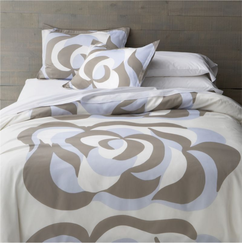 "In its swirling floral forms and dynamic movement, Maija Isola's 1967 design Suudelma (""kiss"") translates the power and passion of human feeling into bold, graphic expression. Reversible duvet cover has hidden button closure at bottom and interior fabric ties to hold the insert in place. Duvet inserts and bed pillows also available.<br /><br /><NEWTAG/><ul><li>100% cotton sateen</li><li>300-thread-count</li><li>Machine wash cold, tumble dry low</li></ul>"