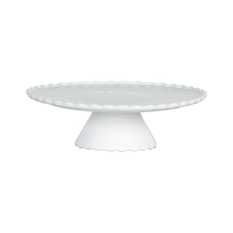 Pretty stoneware pedestal with ruffled rim and base adds patisserie charm to food service.<br /><br /><NEWTAG/><ul><li>Stoneware</li><li>Dishwasher-, microwave-, freezer- and oven-safe to 250 degrees</li><li>Made in Portugal</li></ul>